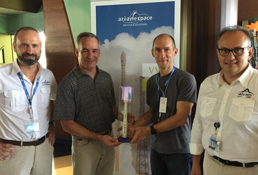 Giulio Ranzo and Avio emploees with a Vega launcher miniature